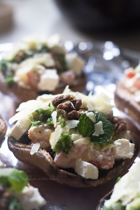 Portobello mushrooms topped with feta, walnuts, sour cream, pesto, tomatoes, mint leaves