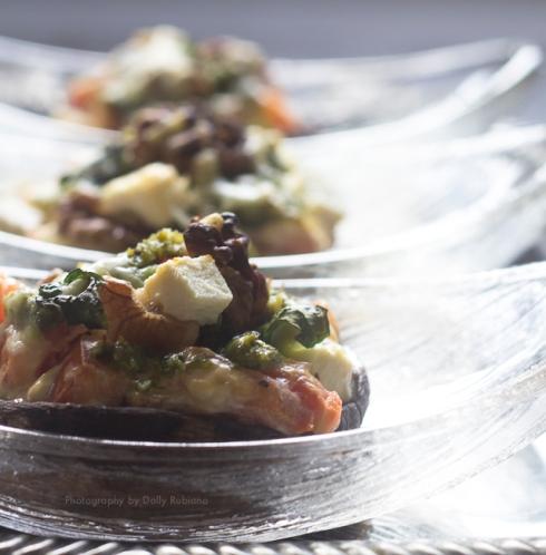 Baked portobello mushrooms with feta, walnuts, sour cream, pesto, tomatoes, mint leaves
