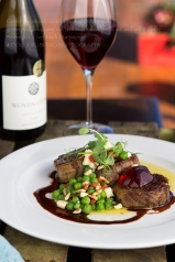 Lamb shoulder with green pea, feta, pine nut and mint salsa, pinot jus and quince jelly
