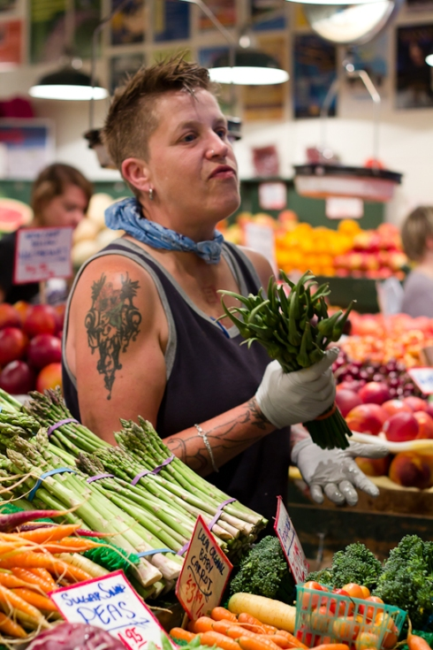 Market vendor with tattoo