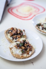 Fried mushrooms with walnuts and goat cheese on pita bread